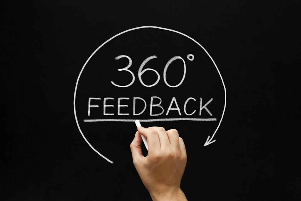 "Writing on a chalkboard of ""feedback"" and ""360"